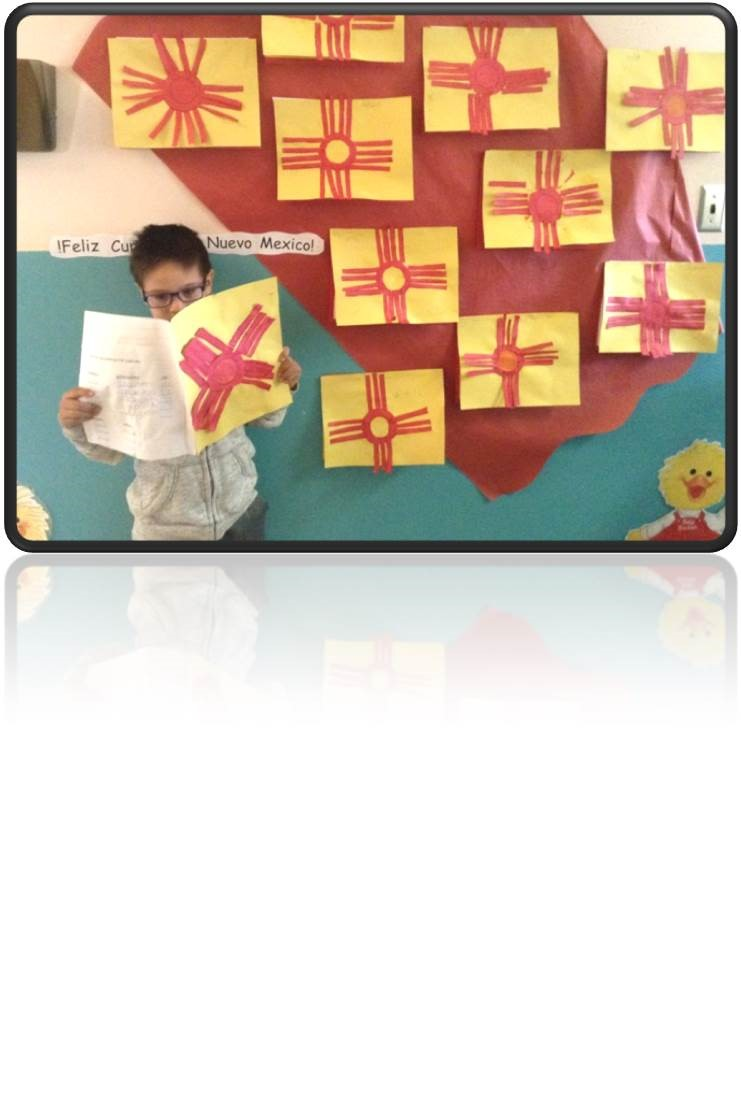 A First Grade student presenting his New Mexico state report