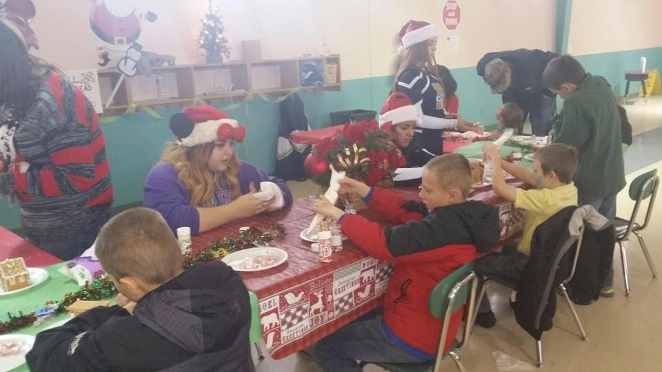 Students making Gingerbread Houses at Morning With Santa